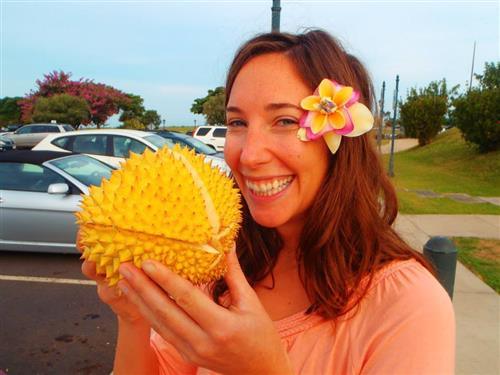Mrs. Gundlach at a farmer's market in Hawaii with a jack fruit