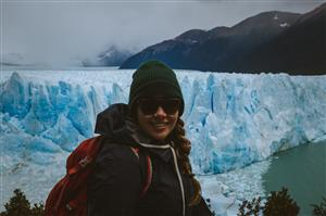 Ms. Criswell by a glacier