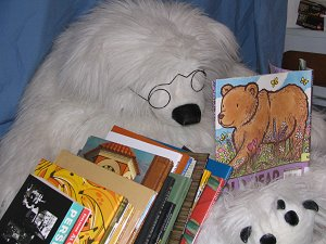 stuffed polar bear reading